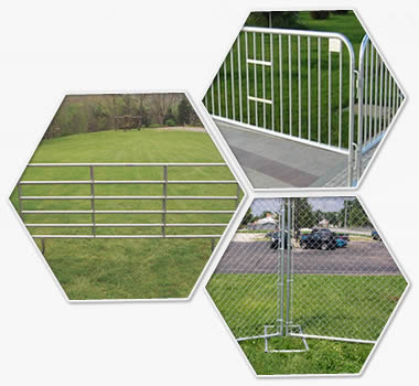 crowd control barrier, chain link temporary fence and corral panels on the grasslands.