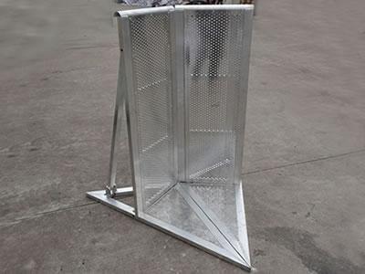 A corner type aluminum stage barrier on the concrete.