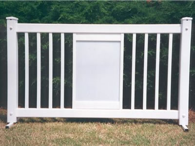 A white display type event fencing panel on the lawn.