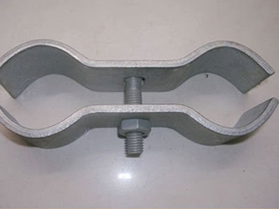 A galvanized Australia temporary fence clamp on the floor.