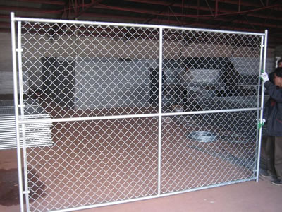 A Large Size Chain Link Temporary Fence Panel Stands On The Floor, The Panel  Has