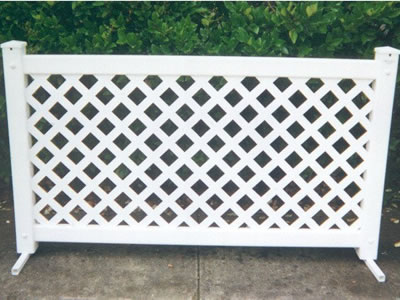 A white lattice type event fencing panel on the ground.