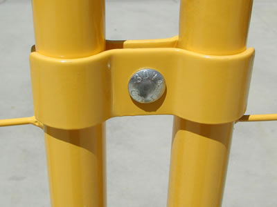 PVC coated temporary fence clamps connect the panels together. They are all painted with yellow.