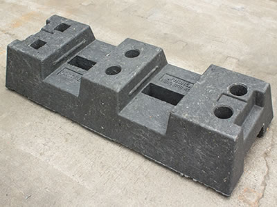 A black rubber feet on the concrete.