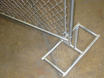 A chain link temporary fence panel installed with a square type galvanized steel feet.