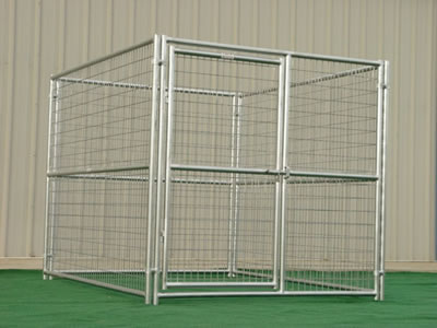 A welded dog kennel laying on the lawn. The kennel consists of four heavy duty temporary fence panels and a gate.