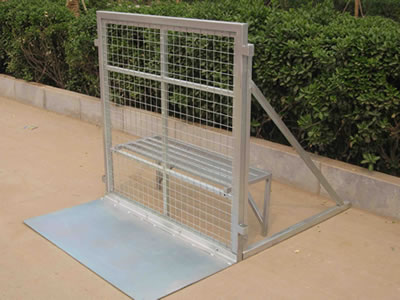 A stage barrier on the roadside and its front panel is welded mesh type.