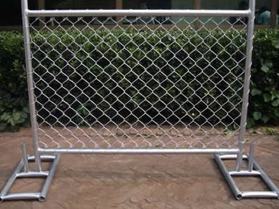A small size galvanized chain link temporary fencing panel standing on the ground with the metal stand support.